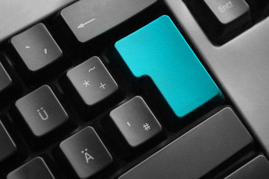 grey keyboard teal colored enter button