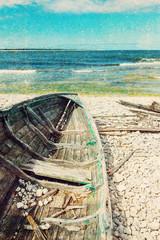 Old wooden boat on the seashore, retro image