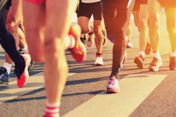 Fototapeta marathon runner legs running on city street obraz