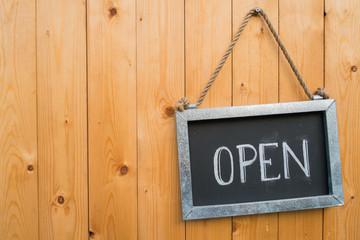 Open Sign On Wood Door