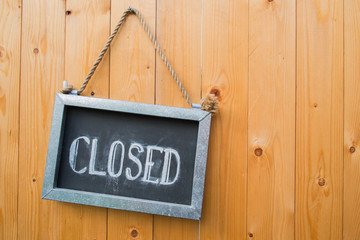 Closed Sign On Wood Door