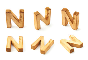 Set of six block wooden letters isolated