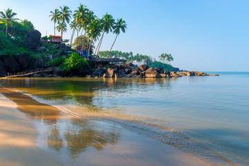 fine sand on a tropical beach and sea waves