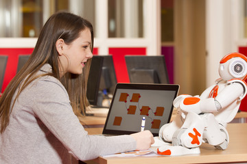Child playing and learning with robot