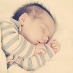 Mother's happiness little sleeping newborn baby