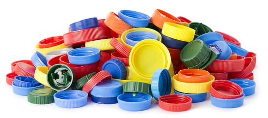 Heap of plastic bottle caps isolated on white background.