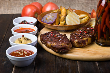 Beef Steaks with Sauces, French Fries and Vegetables