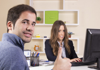 Business girl working in front of desktop at office
