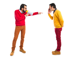 Twin brothers shouting over white background