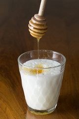 Glass of Hot Foamed Milk with Honey