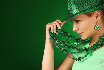 St Patrick's day Girl. Young woman wearing hat over green