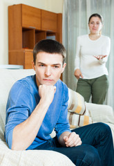 Unhappy guy with aggressive wife