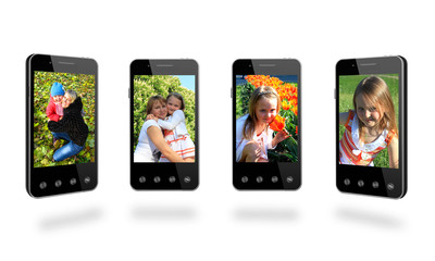 four smart-phones with colored images isolated on the white