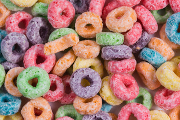 Bright colored o shaped cereal background