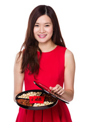 Woman hold with assorted snack tray