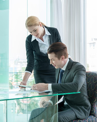 businessman and woman discussing in office