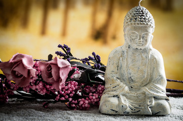 small sculpture of buddha over white pebbles