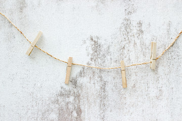 clothesline with line on grunge wall