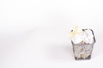 isolated wastebasket full of white waste paper