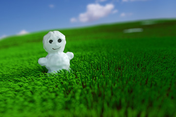 Snowman in the grass