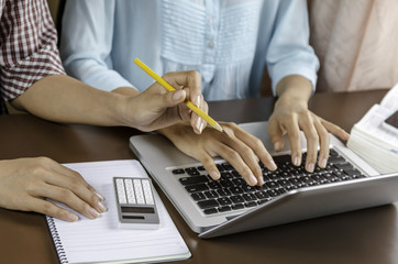 image of two women discussing assignment