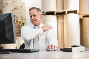 Warehouse manager suffering from shoulder pain