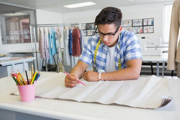 Concentrated college student drawing on paper