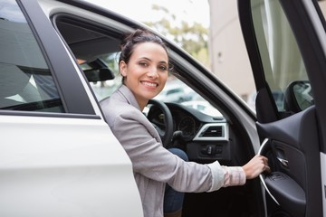 Businesswoman sitting in drivers seat