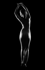 Silhouette of nude woman  isolated on black
