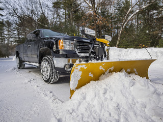 Pickup truck plowing snow Wall mural