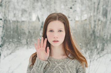 ginger girl in winter forest