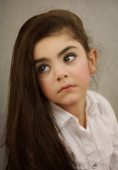Little girl with long hair in vintage style