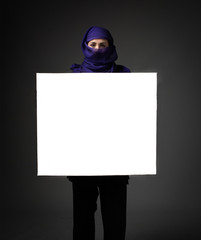 muslim woman with white empty board on hand