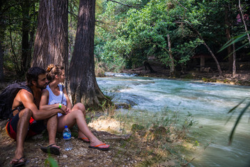 Young Couple Looking at the river, Misol Ha, Mexico. Near San Cr