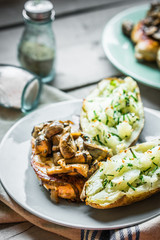 Grilled chicken with mushrooms and baked potatoes