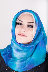 beautiful muslim woman wearing hijab and smiling