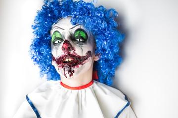 Evil clown on Halloween.Scary professional Halloween masks