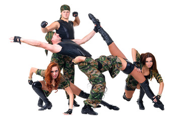 military dancer team dressed in camouflage costumes