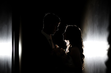 silhouette of the bride and groom at a wedding