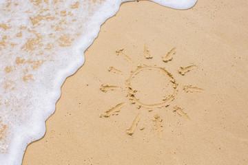 Image of sun drawing on sand