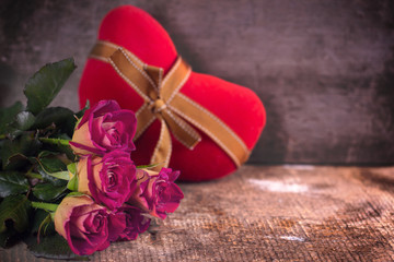 Beautiful flowers roses and decorative heart