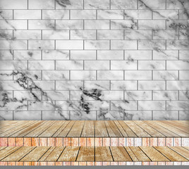 Backdrop marble wall and wood slabs arranged in perspective.