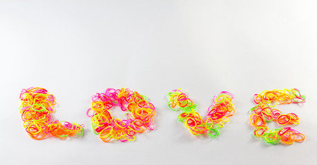Plastic band love word on white background