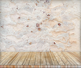 Backdrop sandstone wall and wood slabs arranged in perspective.