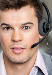 Call Center Employee Wearing Headset In Office