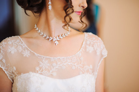 a woman's neck line on her wedding day.