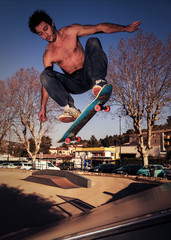 Young man doing an ollie on a skateboard