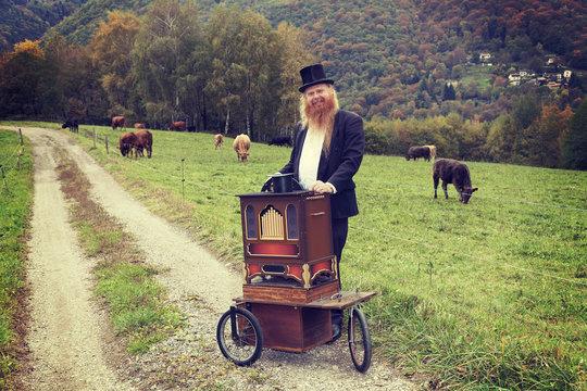 Elegant man playing his cart organ around, portrait