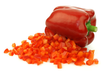 red bell pepper with pieces coming out  on a white background