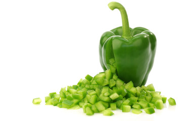 fresh green bell pepper with cut pieces of paprika coming out